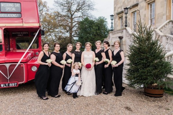 Kathryn's bridesmaids wore mismatched long black dresses of their choice. Her flower girl wore a white dress with an oversized black bow tied around the back.